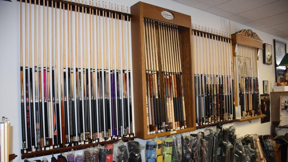selection of pool cues and cases